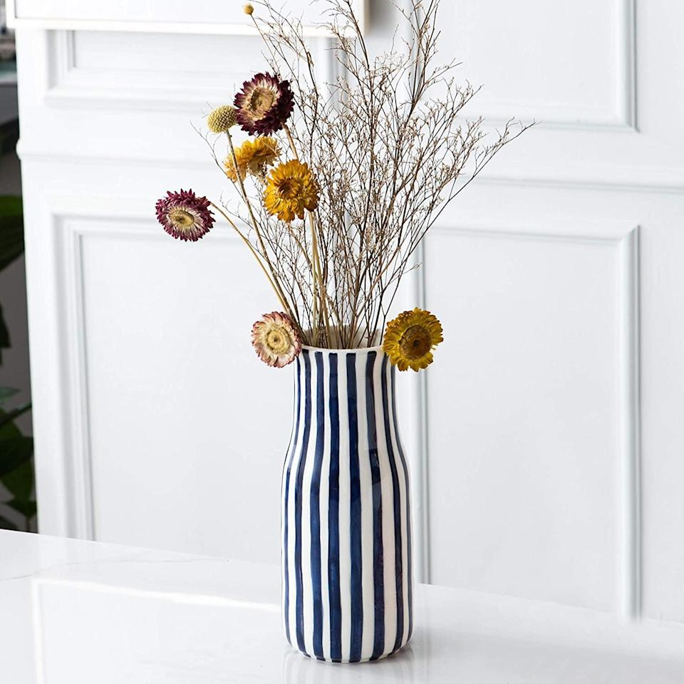 <p>Spice up your end table with this fun <span>Tenforie Ceramic Flower Vase</span> ($20).</p>