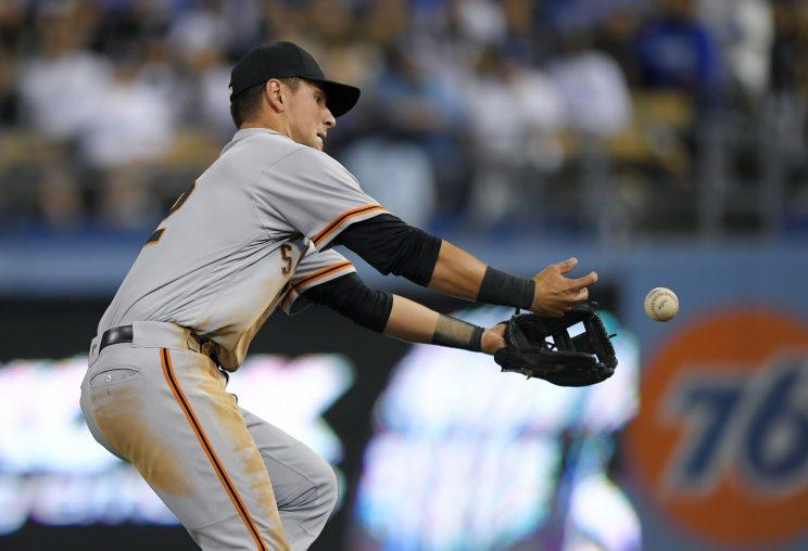 San Francisco Giants second baseman Joe Panik drops a ball hit by Los Angeles Dodgers' Yasiel Puig during the sixth inning of a baseball game, Wednesday, May 3, 2017, in Los Angeles. Puig made it to third on the play and Panik was charged with an error. (AP Photo/Mark J. Terrill)
