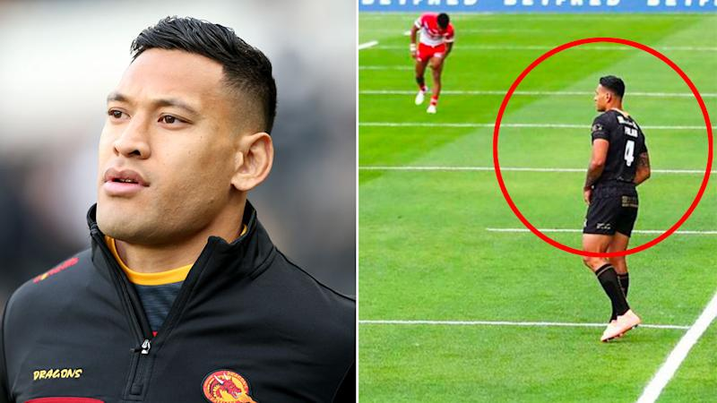 Pictured here, Israel Folau standing before kick-off in contrast to his Catalans teammates.