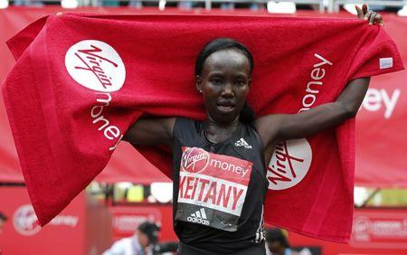 Kenya's Mary Jepkosgei Keitany celebrates winning the Women's Elite race