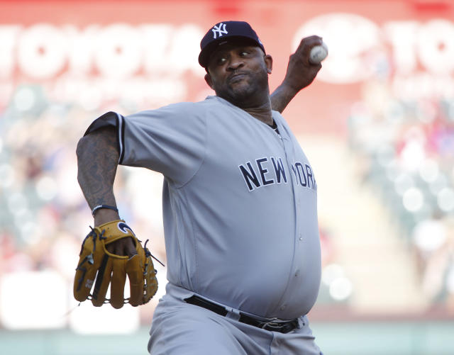 New York Yankees starting pitcher CC Sabathia (52) throws against the Texas Rangers during the first inning of a baseball game Wednesday, May 23, 2018, in Arlington, Texas. (AP Photo/Michael Ainsworth)