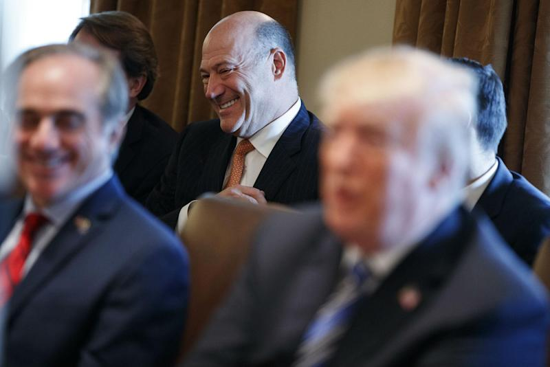 Outgoing White House chief economic adviser Gary Cohn laughs as President Donald Trump talks about him during a cabinet meeting at the White House: AP