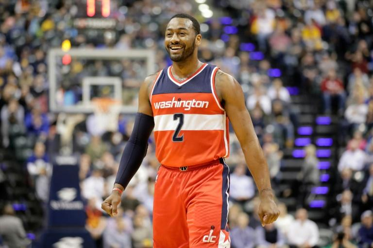 John Wall of the Washington Wizards celebrates scoring a point against the Indiana Pacers, at Bankers Life Fieldhouse in Indianapolis, Indiana, on February 16, 2017