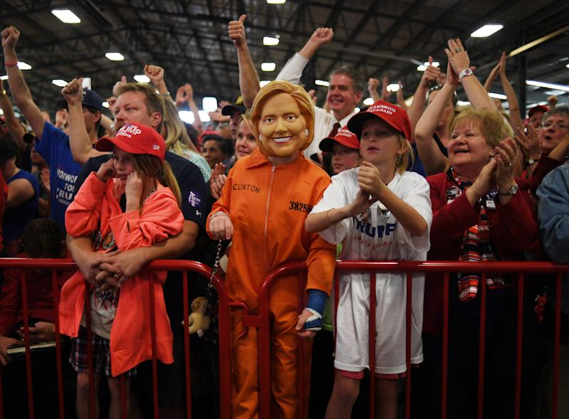 Daniel Lance, 11, dresses as Hillary Clinton in a prison orange jumpsuit during a campaign rally, for Donald J. Trump, at the Jefferson County Fairgrounds in Golden, Oct. 29, 2016. | RJ Sangosti—Denver Post via Getty Images
