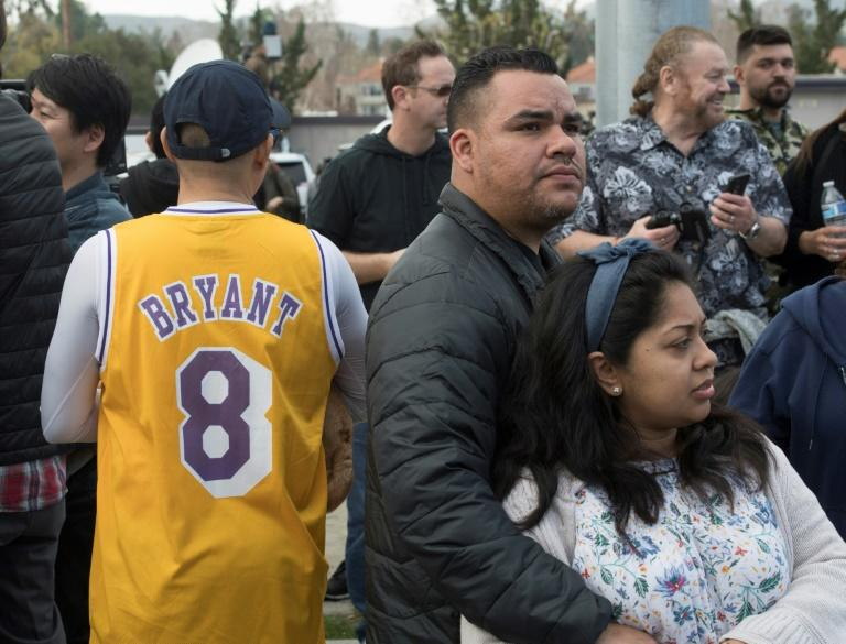 People gather near the scene of a helicopter crash in Calabasas on Sunday that killedLos Angeles Lakers star Kobe Bryant and his daughter Gianna (AFP Photo/Mark RALSTON)