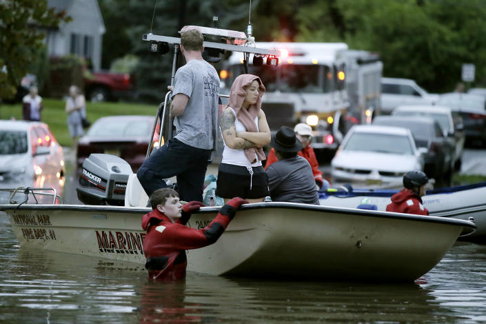 Rescuers guide boats on High St as they bring people to safety after overnight thunderstorms flooded much of Westville, N.J. on Wednesday, June 20, 2019. (Photo: Elizabeth Robertson/The Philadelphia Inquirer via AP)