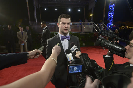 Alabama quarterback AJ McCarron answers questions from members of the media after arriving on the red carpet for the College Football Awards show in Lake Buena Vista, Fla., Thursday, Dec. 12, 2013. (AP Photo/Phelan M. Ebenhack)
