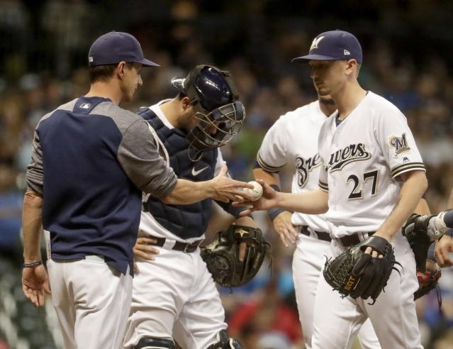 Milwaukee Brewers starting pitcher Zach Davies is taken out of the game during the fifth inning of a baseball game against the New York Mets Thursday, May 24, 2018, in Milwaukee. (AP Photo/Morry Gash)