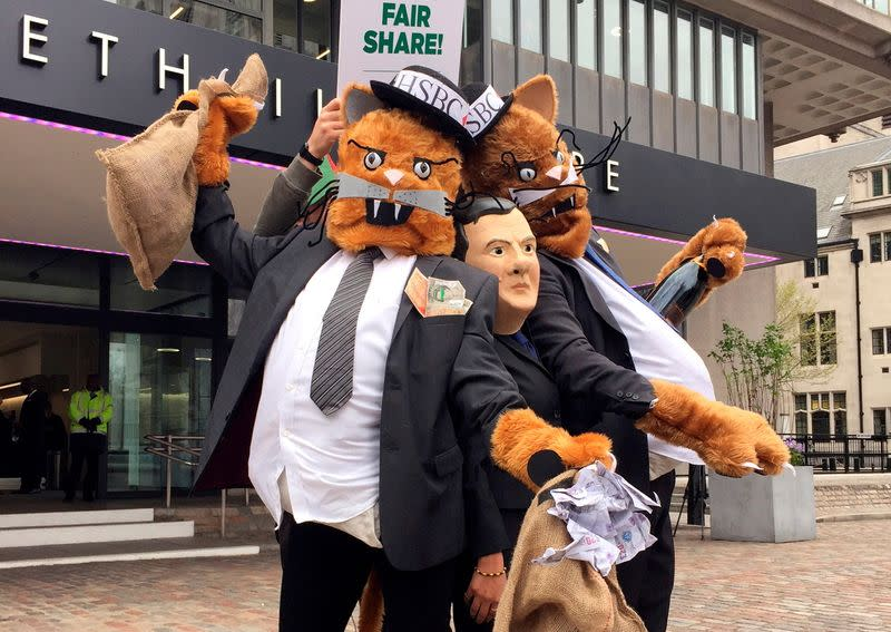 FILE PHOTO: Protestors wearing costumes pose outside the venue for the HSBC AGM in London