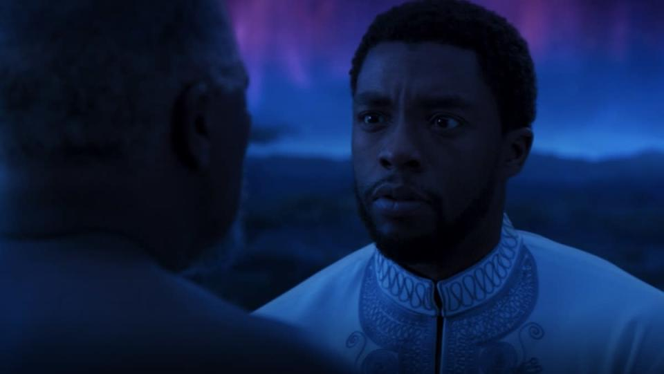 T'Challa meets with his father in the purple and blue sky realm of the Ancestral Plane