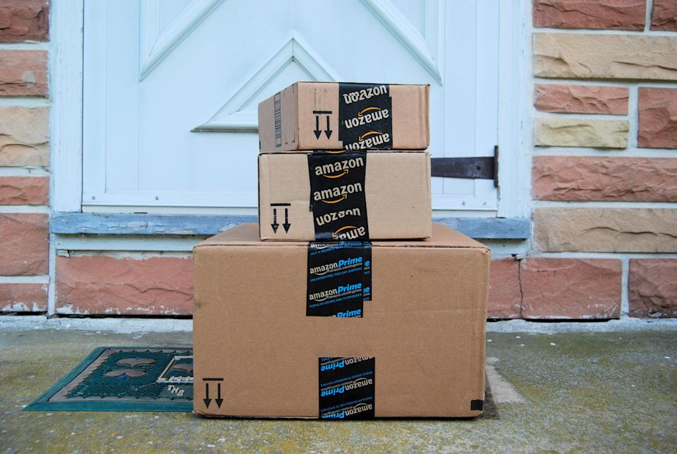 Amazon packages waiting on a home's doorstep. (Photo: Getty)