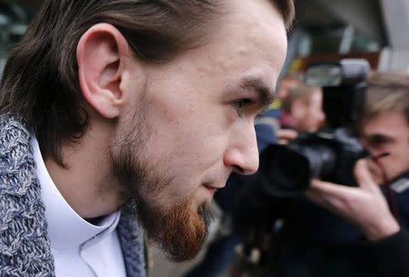 """Michael Delefortrie, who is convicted of being part of """"Sharia4Belgium"""", leaves after the verdict is delivered in a trial of the group in Antwerp February 11, 2015. REUTERS/Francois Lenoir"""