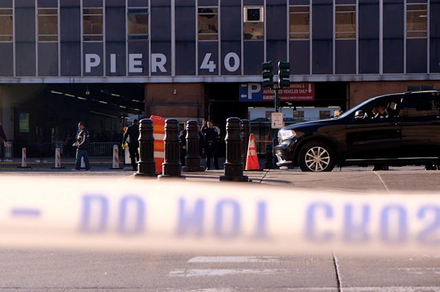 <p>Police gather at the scene after reports of multiple people injured after a truck plowed through a bike path in lower Manhattan on Oct. 31, 2017 in New York City. (Photo: Andy Kiss/Getty Images) </p>