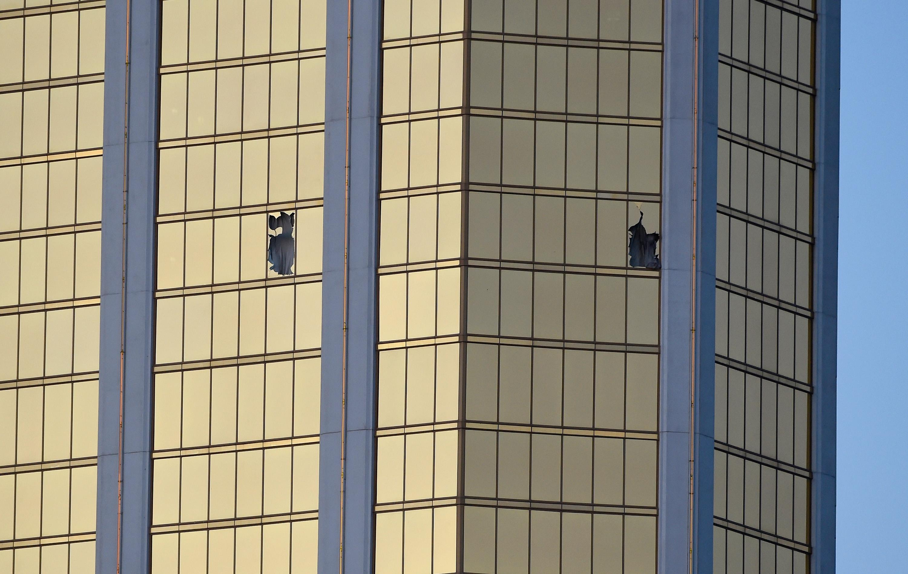 The broken windows of a room on the 32nd floor of the Mandalay Bay Hotel in Las Vegas (Picture: Getty)