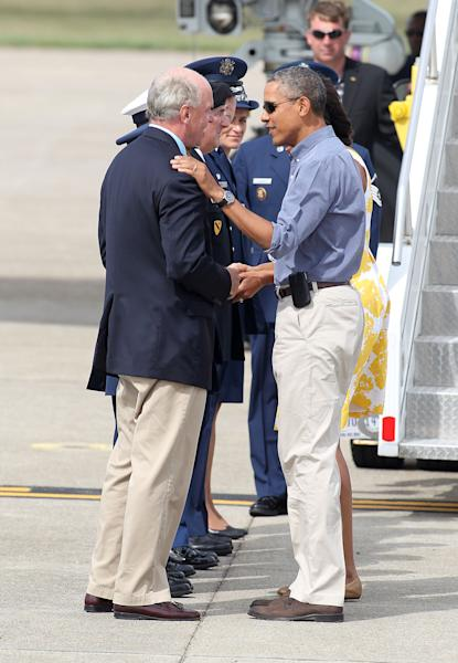 President Barack Obama, left, shakes hands with Rep. Bill Keating, D-Mass., after exiting Air Force One upon arrival at the Cape Cod Coast Guard Station in Bourne, Mass., Saturday, Aug. 10, 2013, en route to a family vacation on Martha's Vineyard. (AP Photo/Stew Milne)