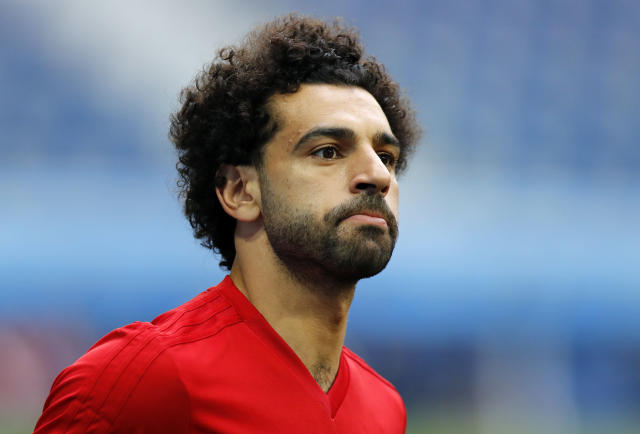 FILE - In this file photo dated Monday, June 18, 2018, Egypt's Mohamed Salah practices during Egypt's official training on the eve of the group A match between Russia and Egypt at the 2018 soccer World Cup, in St. Petersburg, Russia. Chechen leader Ramzan Kadyrov on Friday June 22, 2018, granted honorary citizenship to Salah during a dinner banquet held to say goodbye to Egypts soccer squad, which adopted the Russian regions capital, Grozny, as its base during its World Cup campaign in Russia. (AP Photo/Efrem Lukatsky, FILE)