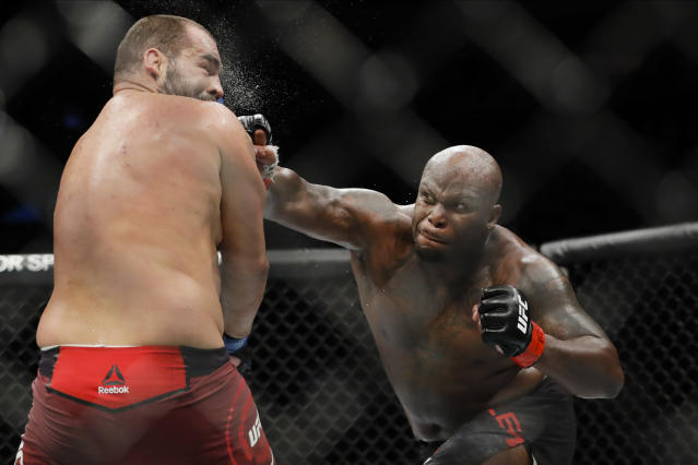 Derrick Lewis, right, punches Bulgaria's Blagoy Ivanov during the second round of a heavyweight mixed martial arts bout at UFC 244, Saturday, Nov. 2, 2019, in New York. Lewis won the fight. (AP Photo/Frank Franklin II)