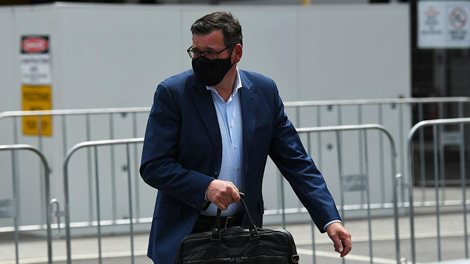 Daniel Andrews wearing a face mask.
