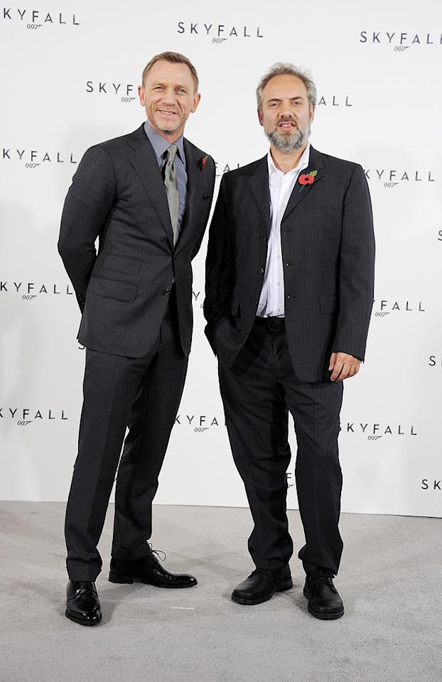 """<a href=""""http://movies.yahoo.com/movie/contributor/1800023173"""">Daniel Craig</a> and Director [c[Sam Mendes attend a photocall with cast and filmmakers to mark the start of production which is due to commence on the 23rd Bond Film and announce the title of the film as """"Skyfall"""" on November 3, 2011 in London."""