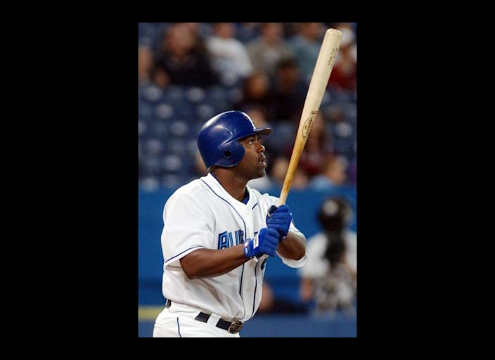 FILE - Toronto Blue Jays' Carlos Delgado hits a three-run home run to center during first-inning AL action against the Tampa Bay Devil Rays in Toronto, in this Sept. 25, 2003 file photo. Blue Jays' Frank Catalanotto and Vernon Wells scored on the hit. Josh Hamilton's historic slugfest Tuesday night May 8, 2012 in Baltimore made him the 16th player in major league history with four homers in a game. Here's how his big night stacks up against the rest. (AP Photo/Aaron Harris, File)