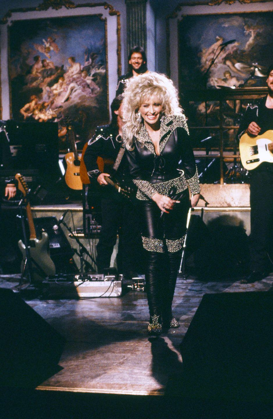 <p>Parton performs on <em>SNL </em>in a sleek, all-leather get-up. </p>