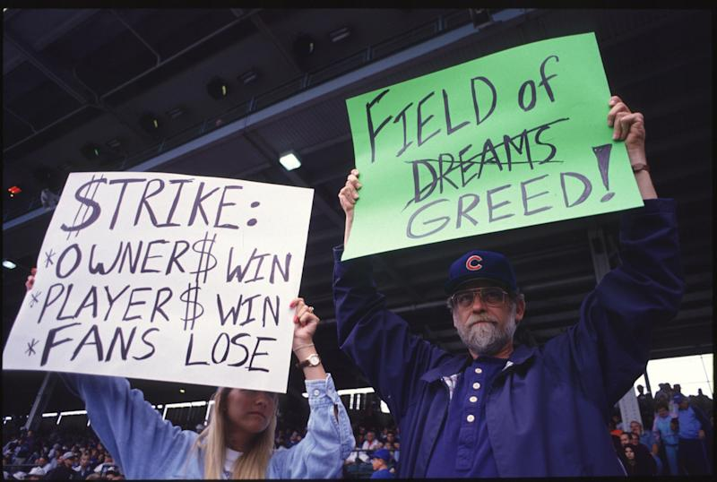 Fans hold up signs in protest of the baseball strike during a game between the San Francisco Giants and the Chicago Cubs in 1994. (Getty Images)