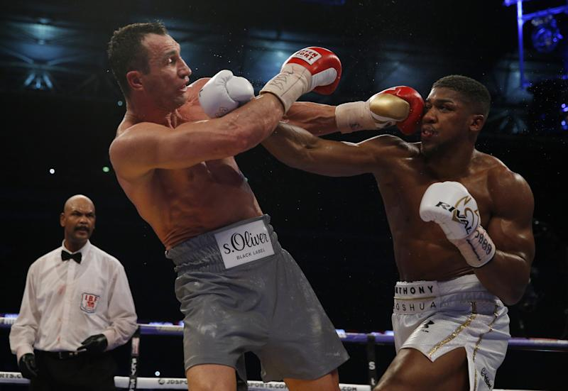 All power: Klitschko and Joshua both picked themselves off the canvas before the Brit's winning blow: REUTERS