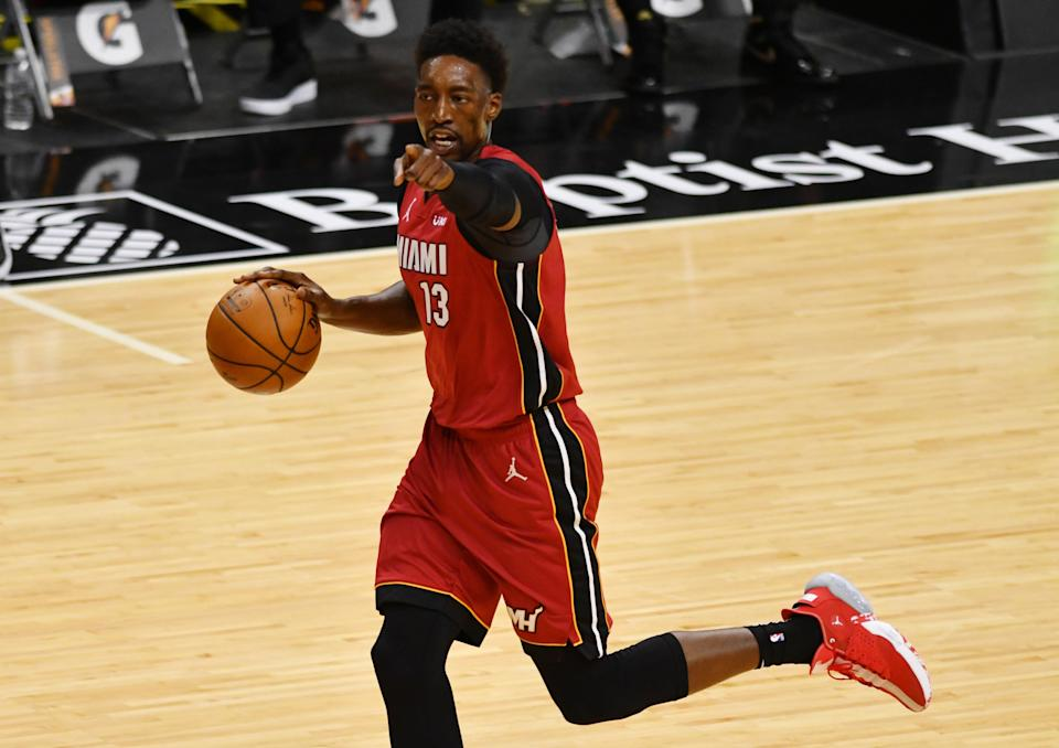 Jan 16, 2021; Miami, Florida, USA; Miami Heat center Bam Adebayo (13) brings the ball up the court against the Detroit Pistons at American Airlines Arena.