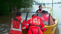 Australia flood waters remain high as emergency services help locals