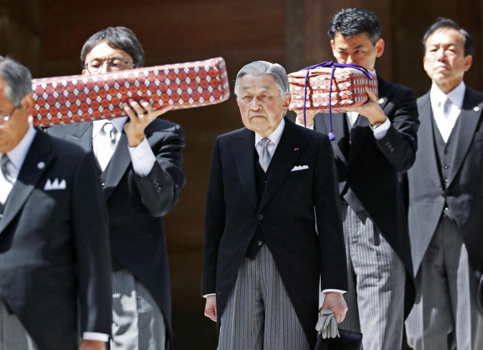 FILE - In this April 18, 2019, photo, Japanese Emperor Akihito, center, visits Ise Grand Shrine, or Ise Jingu, in Ise, central Japan. This is the last trip to a local region for emperor and empress before emperor's abdication. On May 1, 2019, when Crown Prince Naruhito becomes the new emperor. Naruhito will receive a much more important inheritance: The deep respect and affection his father, soon-to-abdicate Emperor Akihito, has accumulated over his three-decade reign.(Kyodo News via AP)