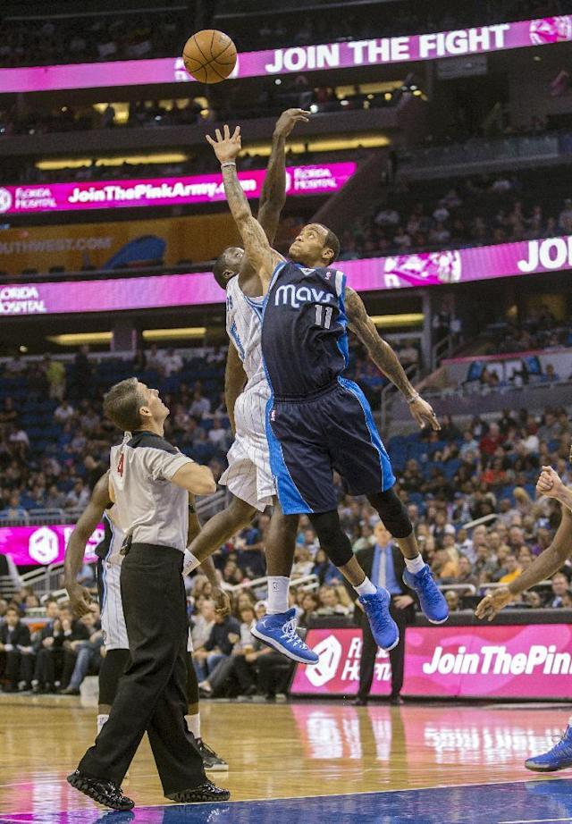 Dallas Mavericks' Monta Ellis, right, and Orlando Magic's Victor Oladipo fight for the jump ball during the first half of an NBA basketball game in Orlando, Fla., Saturday, Nov. 16, 2013. (AP Photo/Willie J. Allen Jr.)