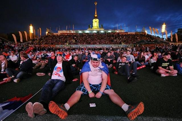 TOPSHOTS Russian football fans reacts while watchin on a giant screen the Group A match between Russia and Greece, in the fan zone in Moscow, on June 16, 2012, during the Euro 2012 football championships. Greece won 1-0. AFP PHOTO/KIRILL KUDRYAVTSEVKIRILL KUDRYAVTSEV/AFP/GettyImages