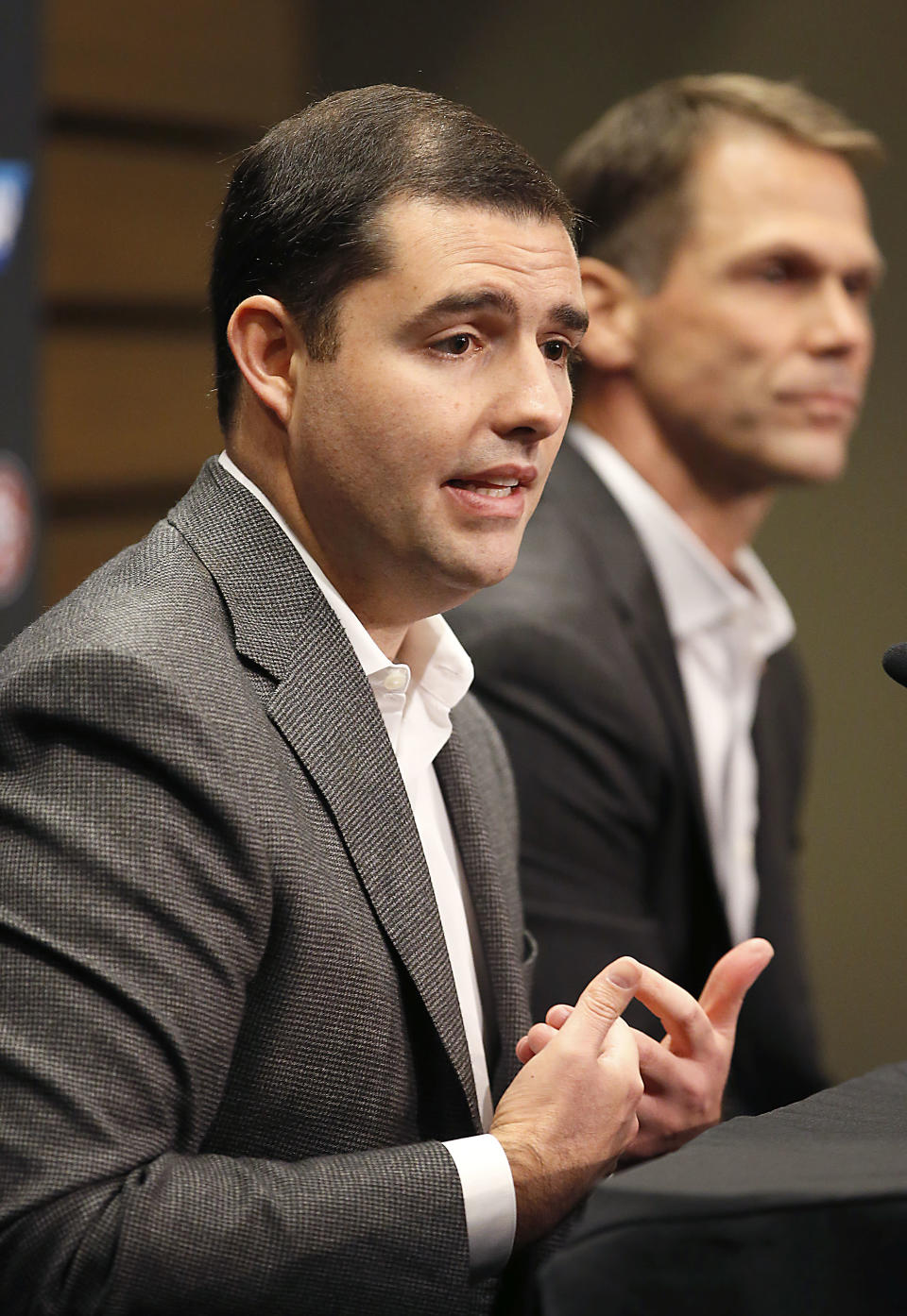 San Francisco 49ers owner Jed York, left, and general manager Trent Baalke, right, speaks during a news conference at 49ers football headquarters in Santa Clara, Calif., on Monday, Dec. 29, 2014. (AP Photo/Tony Avelar)