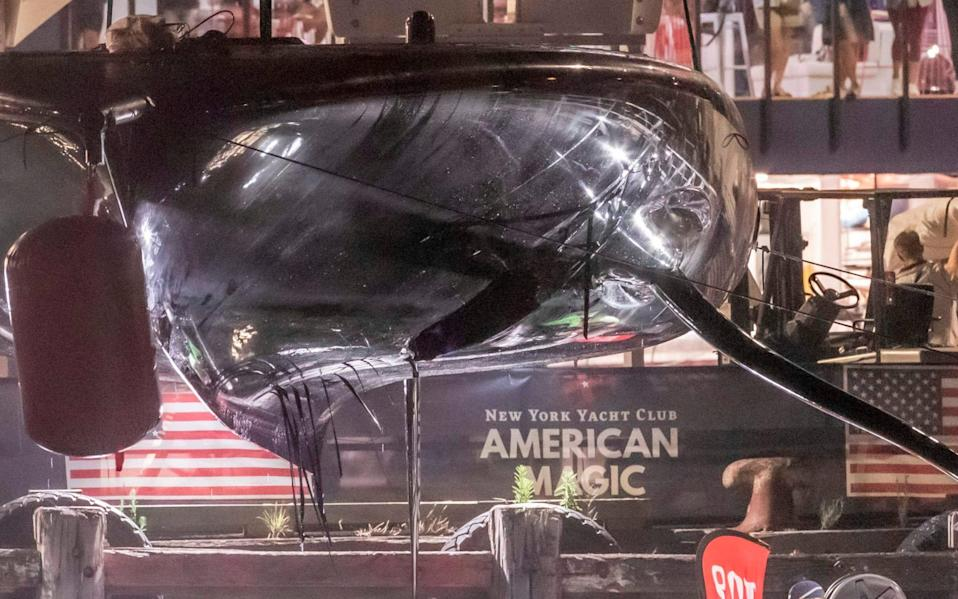 American Magic was left with a huge hole in the underside of the hull - AFP