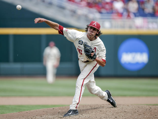 Arkansas pitcher Blaine Knight (16) delivers against Texas in the fifth inning of an NCAA College World Series baseball game in Omaha, Neb., Sunday, June 17, 2018. (AP Photo/Nati Harnik)