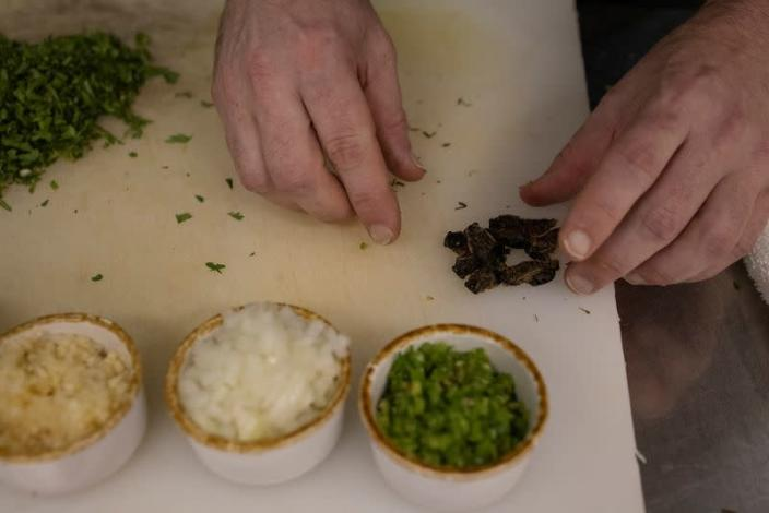 Chef Tobias Padovano prepares cicadas tacos at Cocina on Market restaurant, as Brood X or Brood 10 cicadas have begun emerging from the earth after 17 years, in Leesburg, Virginia U.S.