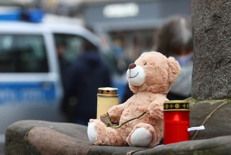 Candles and a teddy bear are pictured at the site where a car crashed into pedestrians in Trier
