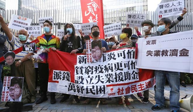 Activists and members of the League of Social Democrats protest for financial aid for the unemployed outside the Legislative Council on February 26. Photo: Jonathan Wong