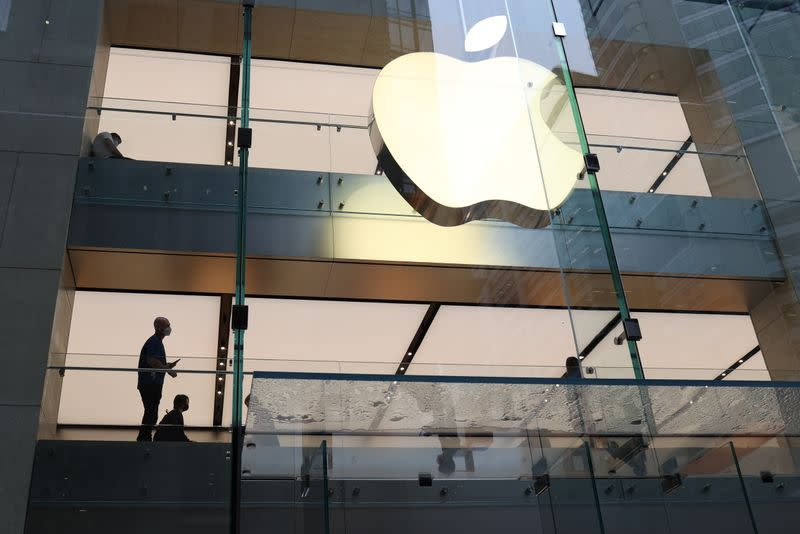 Customers and staff wear protective masks inside an Apple Store in Sydney