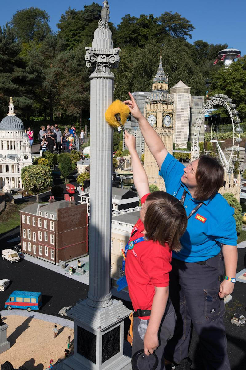 Stanley is pictured here with Paula Laughton, a ‎Models & Theming Coordinator at Legoland Windsor.  (PA Wire/PA Images)