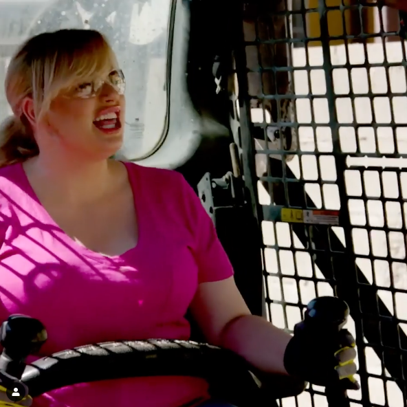 Rebel Wilson operates a bobcat during friend Nicole Leal's backyard transformation on HGTV's 'Celebrity IOU'