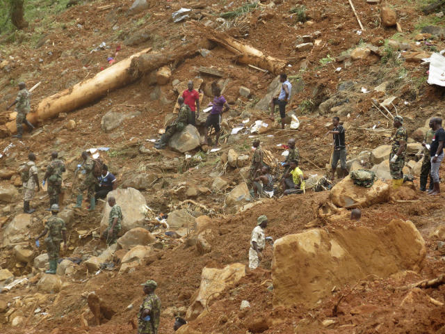 <p>Security forces search for bodies from the scene of heavy flooding and mudslides in Regent, just outside of Sierra Leone's capital Freetown, Aug. 15 , 2017. (Photo: Manika Kamara/AP) </p>