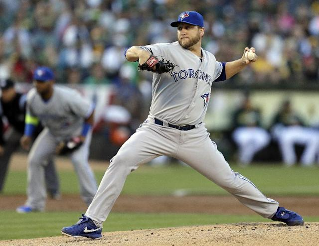 Toronto Blue Jays' Mark Buehrle works against the Oakland Athletics in the first inning of a baseball game on Saturday, July 5, 2014, in Oakland, Calif. (AP Photo/Ben Margot)