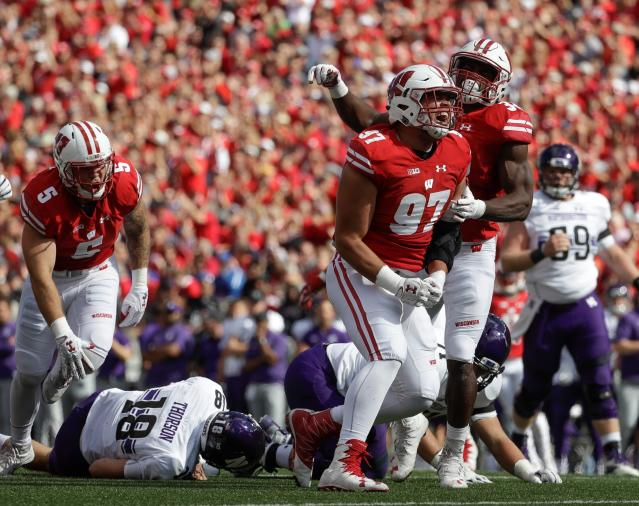 FILE - In this Sept. 30, 2017, file photo, Wisconsin's Isaiahh Loudermilk (97) and Leon Jacobs celebrate after a sack of Northwestern quarterback Clayton Thorson (18) during the first half of an NCAA college football game in Madison, Wis. As a backup last season, Laudermilk, the 6-foot-7, 297-pounder had 11 tackles and 1.5 sacks in 11 games. (AP Photo/Morry Gash, File)