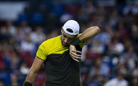 <span>Matteo Berrettini of Italy looks dejected during his match against Alexander Zverev</span> <span>Credit: Getty Images AsiaPac </span>