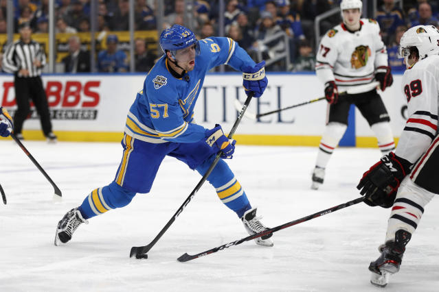 St. Louis Blues' David Perron shoots during the second period of an NHL hockey game against the Chicago Blackhawks Saturday, Dec. 14, 2019, in St. Louis. (AP Photo/Jeff Roberson)