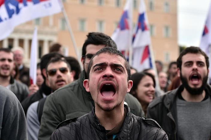 Demonstrators shout slogans beside the Greek parliament in Athens during a massive protest on February 4, 2016 (AFP Photo/Louisa Gouliamaki)
