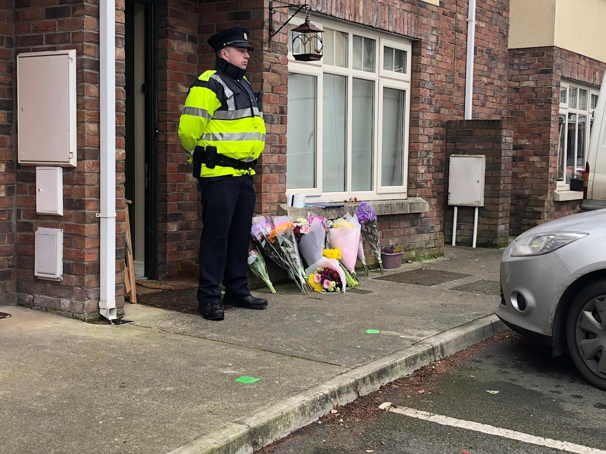Flowers outside a house in the village of Newcastle, south west of Dublin city where three children were found dead on Friday.