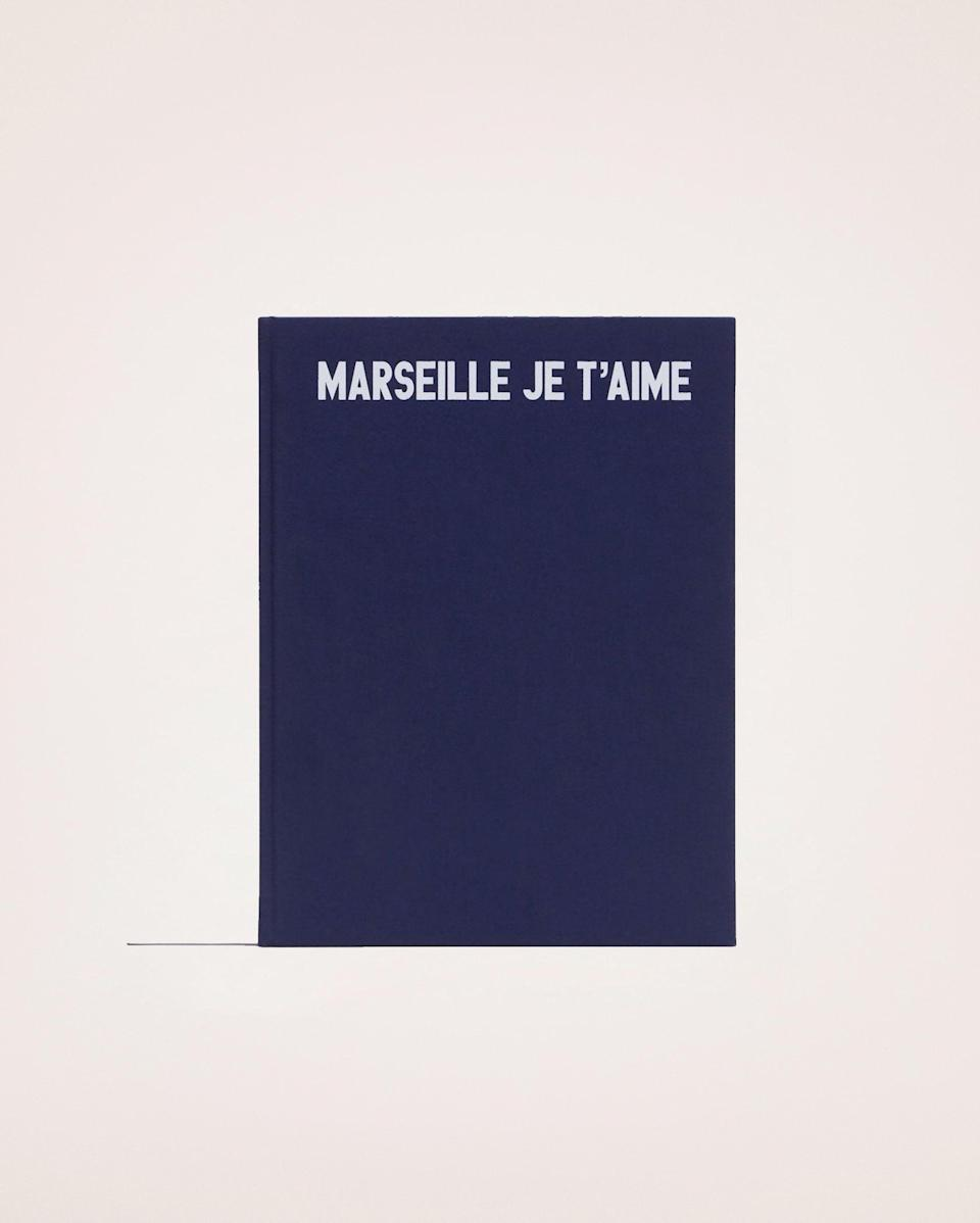 "If they can't travel to France this year, we suggest gifting them Simon Porte Jacquemus' photo book of the designer's home in the country's southern region so they can play pretend. <br><br><strong>Jacquemus</strong> Marseille Je T'aime, $, available at <a href=""https://go.skimresources.com/?id=30283X879131&url=https%3A%2F%2Fwww.jacquemus.com%2Fproduct%2Fmarseille-je-t-aime-book-one-size-3700943608833"" rel=""nofollow noopener"" target=""_blank"" data-ylk=""slk:Jacquemus"" class=""link rapid-noclick-resp"">Jacquemus</a>"