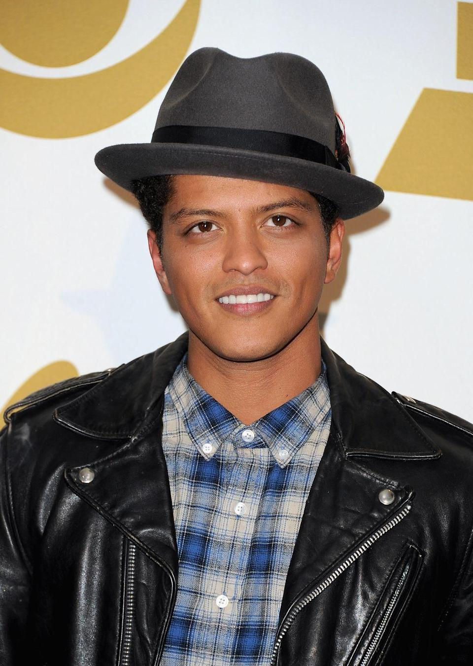 <p>When Bruno Mars entered the scene, his melodic songs and retro style was part of his widespread appeal. The singer channeled old-fashioned crooners, sporting fedoras at almost every single event. Now we can't look at a fedora without thinking of Mars. </p>